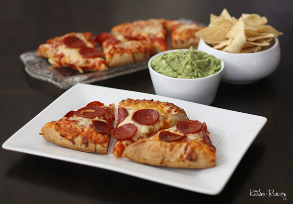 Digiorno pizza served with guacamole and chips makes for an easy meal for Sunday football!